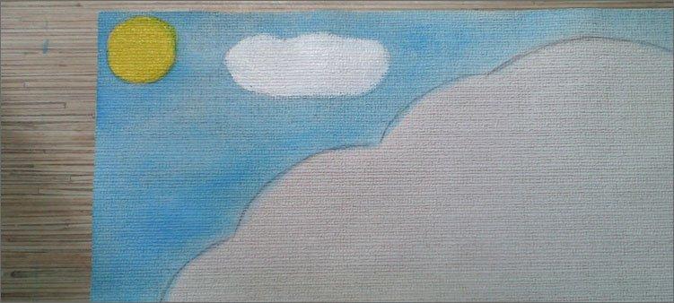 на-листе-бумаги-нарисовано-небо-солнце-и-облако