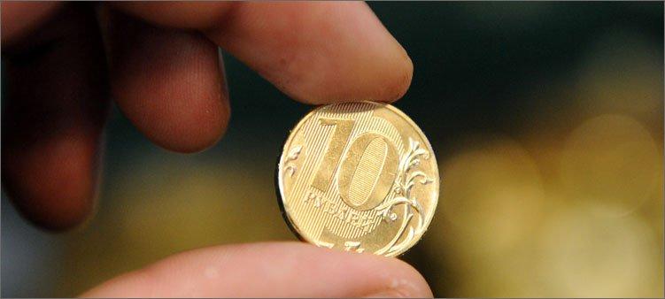 монета-в-руке