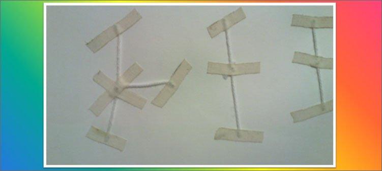 нитки-закреплены-пластырем-на-задней-стороне-ватмана